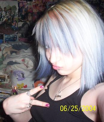 emo chick throwing up the dueces